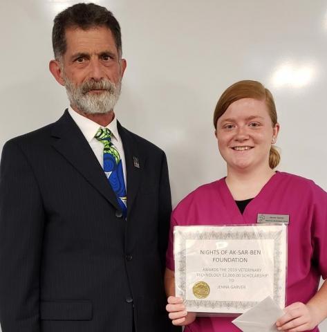 NCTA Dean Ron Rosati with vet tech student Jenna Garver of Hastings. (NCTA photo)