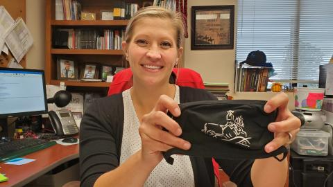 Animal Science Professor and Ranch Horse Team Coach Jo Hergenreder displays her mask of horse and rider. She keeps it handy for use in the office and classroom. (Crawford / NCTA News)
