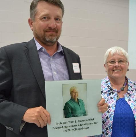 Justin Jarecke, APS '95, honors Animal Science Professor Jo Bek with a Legacy Tile at the 2016 alumni banquet.
