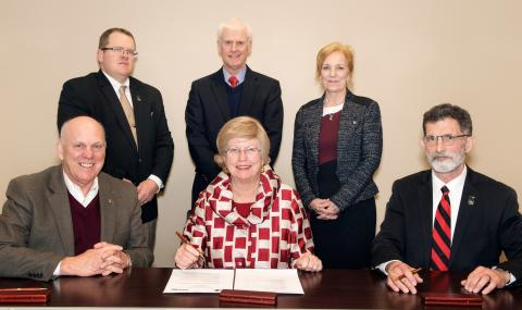 Attending the NCTA-MSU partnership signing are, (seated, left to right) George Hopper, dean of MSU's College of Agriculture and Life Sciences; Judy Bonner, MSU provost and executive vice president; and Ron Rosati, NCTA dean. (Standing, from left) Professor Doug Smith, chair of NCTA Animal Science and Agricultural Education; Peter Ryan, MSU associate provost for academic affairs; and Professor Mary Beck, head of MSU's Department of Poultry Science. (Photo by Beth Wynn/MSU)