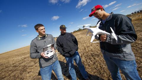 A file photo shows Aggie students learning to operate an aerial crop drone at the NCTA farm. (Craig Chandler / University Communication)