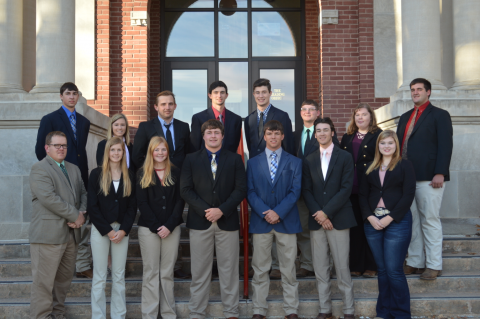 Livestock Judging Team students in a November, 2018, photo at NCTA Ag Hall are, back row: (L to R) Dean Fleer, assistant coach; Colbey Luebbe, Grant Romshek, Remy Mansour, Will Moeller, Peyton McCord, Rachel Miller, and Nathan Lashley, assistant coach. Front row: (L to R) Dr. Doug Smith, coach; Tiffany Dickau, Emily Riley, Seth Racicky, Camden Wilke, Garrett Lapp, and Maisie Kennicutt. (Tina Smith/NCTA Photo)