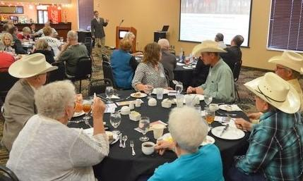 """NCTA Dean Ron Rosati provided a """"Campus Update"""" to nearly 90 Aggie alumni and friends in Broken Bow. Larry Trumbull (left, foreground) graduated in 1947. (Crawford/NCTA Photo)"""