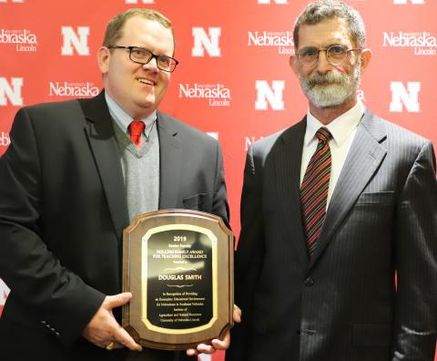 Dr. Douglas Smith, at left, received the IANR Holling Family Award for Teaching Excellence. NCTA Dean Ron Rosati attended the presentation ceremony in Lincoln. (Lana Johnson / IANR Photo)