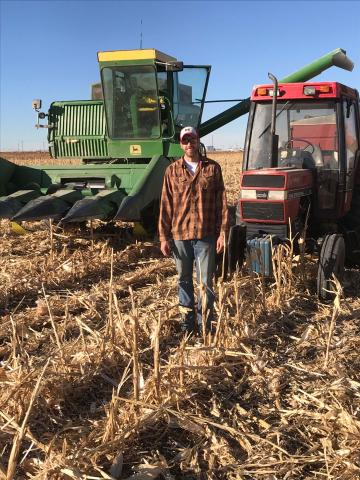 Ross Steward harvests corn at the USDA-ARS Limit Irrigation Research Farm near Greeley, Colorado. The native of Littleton credits trips to his grandparents' farm and his college years, both in Nebraska, for a career path in crop management. (Courtesy photo)