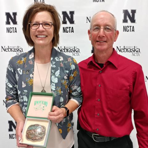 Joan and Steve Ruskamp of Dodge, UNSTA alumni from '80 and '76, returned to Curtis for 2019 Commencement where Joan gave a keynote message to graduates. She received an NCTA belt buckle. (NCTA photo)