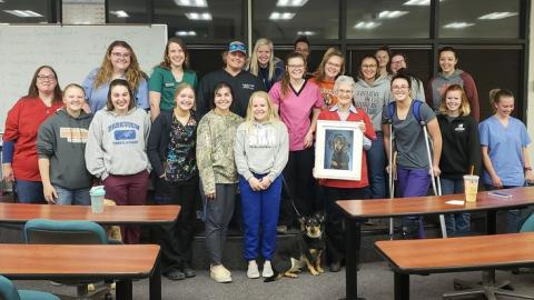 Vet Tech students in STVMA celebrate their instructor and mentor, Ricky Sue Barnes Wach, D.V.M., by presenting her with art. She retired in July and will continue on the NCTA faculty as a part-time lecturer. (C. Barnhart photo / NCTA)