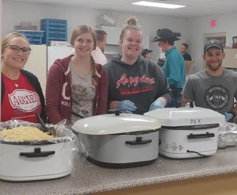 NCTA students serving pasta at the NCTA Nebraska Disaster Relief Benefit (left to right) are Brianna Schuck, Harvard, Tiffany Dickau, Elwood, Emily Giese, Papillion, and Keegan Jones of Laurel, Maryland. More photos can be viewed in the PDF at the end of this article. (C. Hauptman / NCTA photos)
