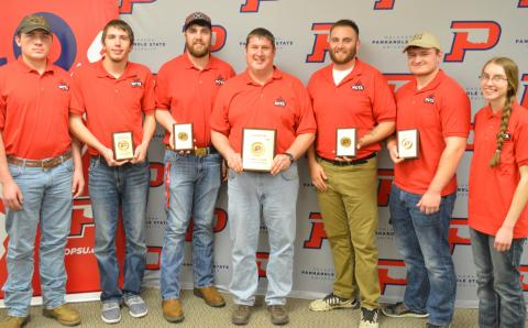 Agronomy team members flank their coach and instructor, Dr. Brad Ramsdale, after the NCTA Aggies won first place in a contest Saturday at Goodwell, Oklahoma. NCTA had the top four individuals, as well. From left, Jacob Valley, Plattsmouth; Lee Jespersen, Hemingford, tied for 3rd; Will Kusant, Comstock, 2nd; Coach Ramsdale with 1st place team plaque; Nate Montanez, Grand Island, 3rd tie; Dalon Koubek, North Platte, 1st place; and Catherine Ljunggren, Harvard. (Brent Thomas/NCTA News Photo)