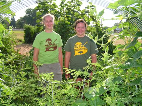 The NCTA Horticulture Club is hosting a plant sale at the campus greenhouse in Curtis on April 30 and May 5. Tee Bush and Regan Garey, both of Curtis, at the community garden in 2014. (NCTA News photo)