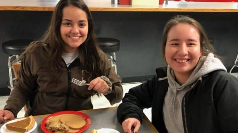 NCTA students Aaliyah Segura of Scottsbluff, left, and Courtney Anderson of Sioux Falls, South Dakota, enjoy a Thanksgiving meal at Aggie Dining before their holiday break. (Photo by NCTA student Annie Bassett)