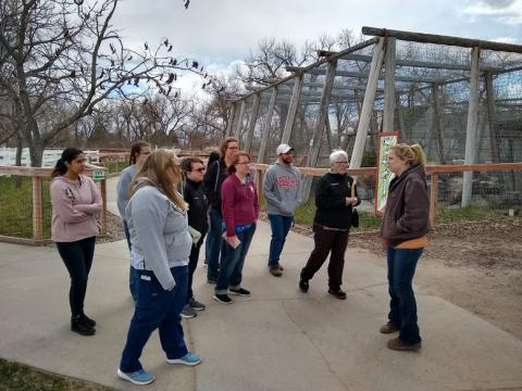 Vet Tech students in the NCTA Exotic Animal class tour the Riverside Discovery Center in Scottsbluff with their classmate Shay Nealon, far right, who is served her internship with the zoo. (Crawford / NCTA photo)
