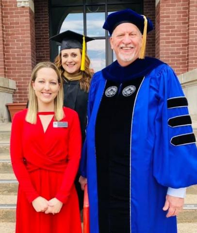 Josi Arnold, recipient of the IANR Inclusive Excellence Award, often lends a helping hand to students and staff at NCTA. Campus deans Jennifer McConville and Larry Gossen joined Arnold at steps of Ag Hall for the outdoor commencement in May. (NCTA Photo)