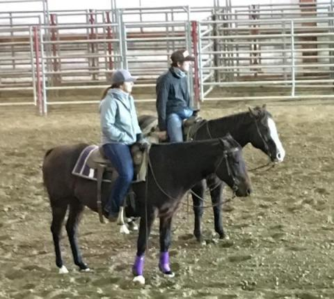 NCTA Ranch Horse team members Whitney Hall of Alliance and Shane Hoer of Blair  gain horsemanship pointers from clinician Sherman Tegtmeier. (NCTA photo)