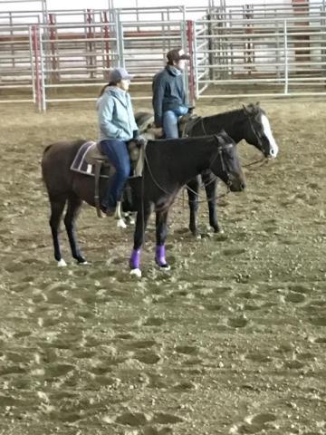 NCTA Ranch Horse team members Whitney Hall of Alliance and Shane Hoer of Blair  gain horsemanship pointers from clinician Sherman Tegtmeier. (NCTA photo)