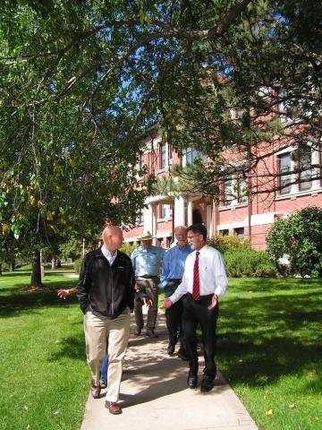 NCTA Dean Ron Rosati leads a campus tour below the huge trees near Ag Hall in 2014. (NCTA photo)