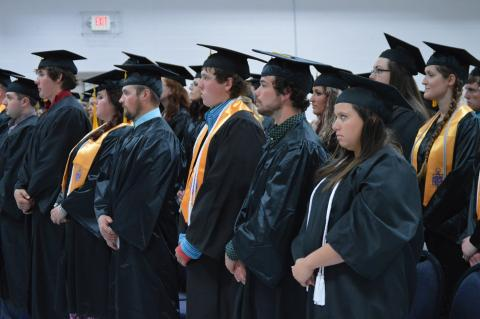 NCTA Class of 2016 graduates rise to move their tassels on their mortarboards from right to left. Governor Pete Ricketts was a keynote speaker for the May 5 commencement in Curtis. (NCTA photo)