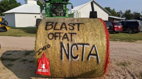 NCTA recruits with a hay bale at the Frontier County Fair in Stockville – with a 4-H rocketry project theme. (NCTA Photo / Gaylene Stinman)