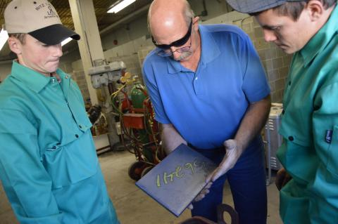 Agricultural mechanics instructor Dan Stehlik shows welding students some of the materials donated by an industry partner to the welding laboratory. (Crawford / NCTA photo)