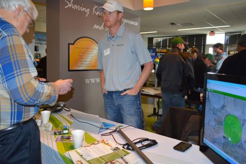 Ted Tietjen of Grant, Neb., discusses irrigation technology and tools with Jared Kruntorad, Ewing, Neb., sales manager of FieldWise LLC, during the 2015 irrigation management conference at NCTA in Curtis. (NCTA photo)