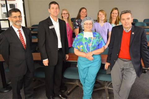 NCTA Dean Ron Rosati, at left, and Veterinary Technology Division Chairman Barbara Berg, center, join NCTA Vet Tech staff and students in hosting NU administrators Hank Bounds and Ronnie Green during a campus visit in April, 2015.