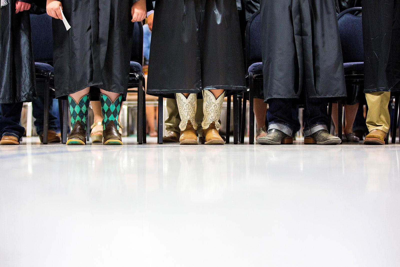 Feet of student graduating wearing cowboy boots.